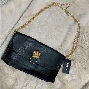 Lion emblem shoulder bag